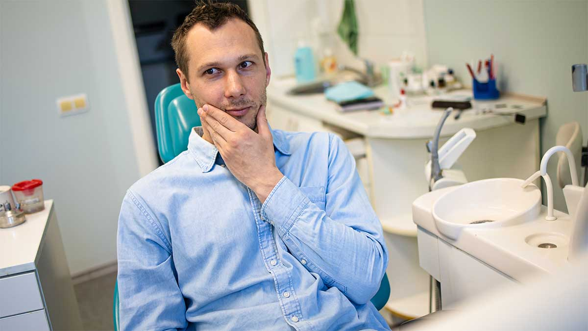 patient with no pain after dental implant surgery